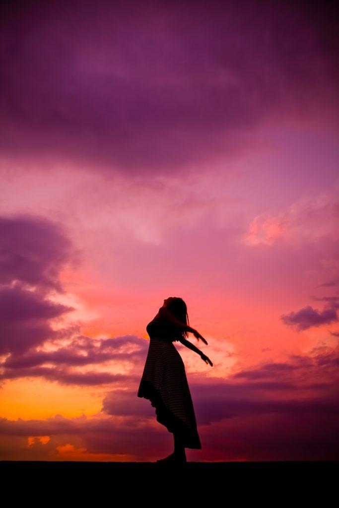 A girl facing towards sky.